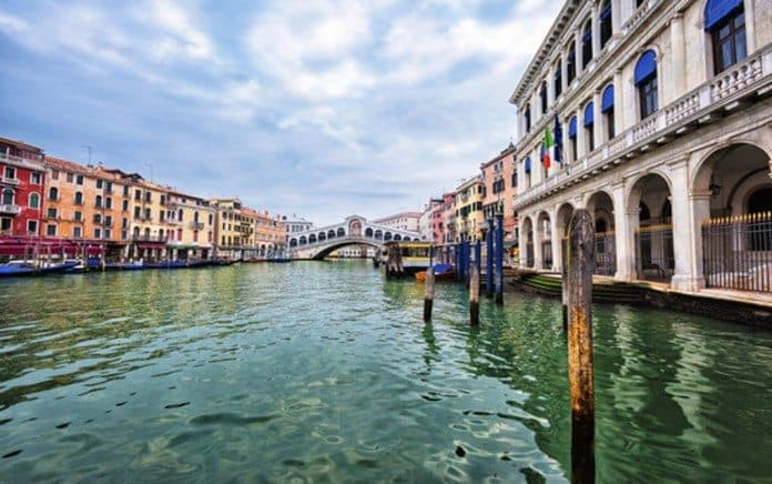 View of Venice with Rialto bridge on Grand Canal, Italy